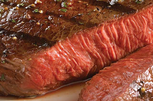 Picture of a freshly made steak at Bravos California Fresh.